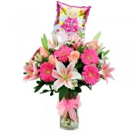 Florero de Nacimiento Niña con Globo Rosas Liliums y Gerberas Rosadas